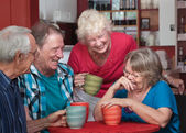 Laughing Friends in Coffeehouse — Stock Photo