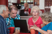 Shocked Seniors with Laptop — Stock Photo