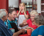 Young Waitress and Arguing Seniors — Stock Photo