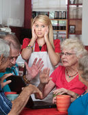 Bickering Seniors and Young Waitress — Stock fotografie