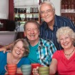 Laughing Seniors in Cafe — Stock Photo