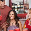 Hispanic Woman with Friends - Stock Photo