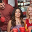Stock Photo: Joyful Diverse Adults with Coffee