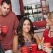 Native Woman with Friends in Cafe — Stock Photo