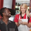 Stock Photo: Waitress Taking Orders at Cafe
