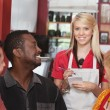 Waitress with Diverse Customers — Foto Stock