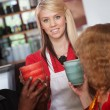 Waitress with Mugs and Patrons — Stock Photo