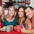 Happy Friends at Cafe Table — Stockfoto