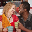 Smiling Mixed Couple Having Coffee — Stock Photo #17982789