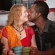 Mixed Eskimo Kiss in Cafe — Stock Photo