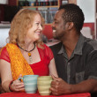Smiling Mixed Couple in Cafe — Stock Photo