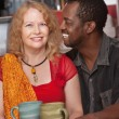 Attractive Mixed Couple in Restaurant — Stock Photo
