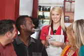 Waitress with Diverse Customers — Stock Photo