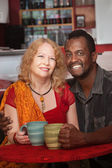 Happy Mixed Couple in Coffeehouse — Stock Photo