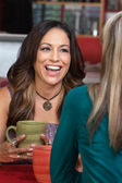 Mature Woman in Cafe Laughing — Stock Photo
