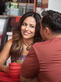 Skeptical Woman Looking at Man in Cafe — Stock Photo