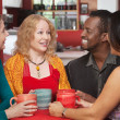 Stock Photo: Joyful Group of Four in Cafe
