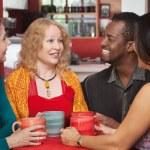 Joyful Group of Four in Cafe — Stock Photo