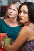 Concerned Ladies in Coffeehouse — Stock Photo