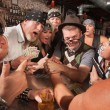 Stock Photo: Nerd Arm Wrestling with Gambling Bikers