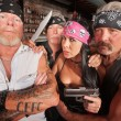 Four Tough Bikers in a Bar — Stock Photo