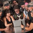 Nerd on Computer with Bikers - Stock Photo