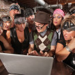 Постер, плакат: Biker Gang Interested in Nerd on Laptop