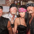 Foto Stock: Biker Gang Members with Woman