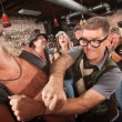 Foto de Stock  : Geek Punches Gang Member