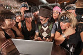 Biker Gang Interested in Nerd on Laptop — Stock Photo