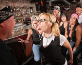 Nerd Sticking Out Tongue in Bar — Stock Photo
