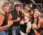 Nerd Holds Up Fists with Gang in Bar — Stock Photo