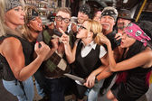 Woman Pointing at Thugs in Bar — Stock Photo