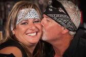 Mature Bearded Man Kisses Woman — Stock Photo