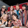 Happy Patrons Holding Pizza — Stock Photo #21659509