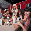 Woman with Friends at Mobile Cafe Table — Stock Photo #21822431