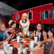 Friends Talking and Dining on Pizza — Stok fotoğraf