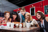 Friends Smiling Near Food Truck — Foto Stock