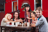 Smiling Hipster with Friends Eating — Stock Photo