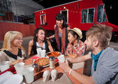Hipsters with Plates of Pizza — Stock Photo