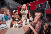 Woman with Friends at Mobile Cafe Table — Stock Photo