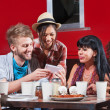Diverse Group Eating and Texting — Stock Photo