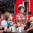 Lady Serving Pizza Outdoors — Stock Photo