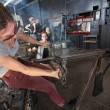 Cooling Hot Glass with Mitt - Stock Photo