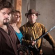 Stock Photo: Three Sword Fighters in Dungeon
