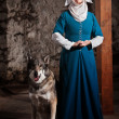 Nun with Dog Indoors — Stock Photo