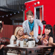 Mixed Group Eating at Restaurant — Stock Photo