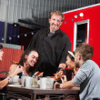 Canteen Owner with Happy Diners - Stock Photo