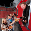 Pizza Dinner at Food Truck - Stock Photo