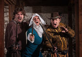 Swashbucklers and Nun with Swords — Stock Photo